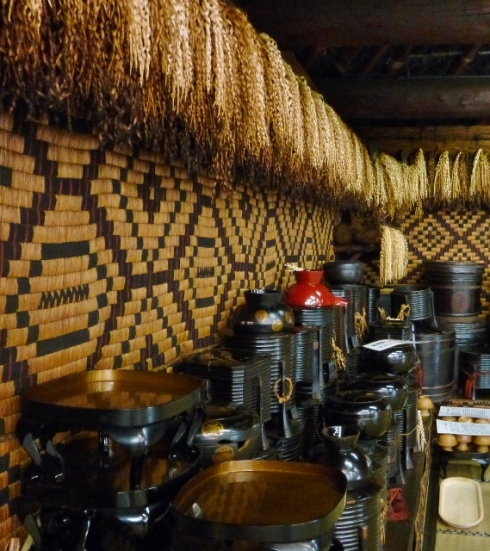 Ainu house with lacquerware and inaw
